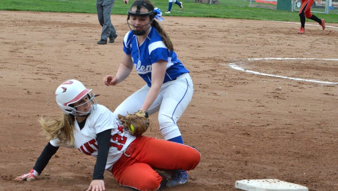 Salem third baseman Mel Anderson slaps a tag on Canton baserunner Hannah Zajdel during Tuesday's varsity girls softball matchup.