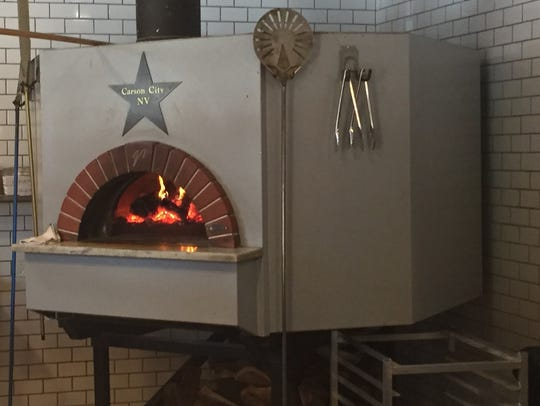 A wood-fire oven glows at the Union Eatery Taphouse