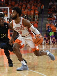 Clemson guard Gabe DeVoe (10) drives past Pitt guard