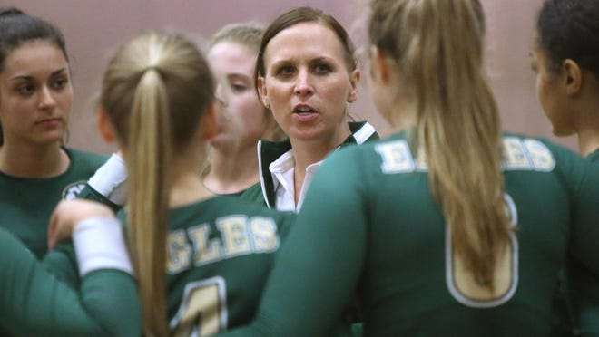 GlenOak volleyball coach Deb Pickering (center) talks to her team before an Aug. 30, 2018 match at Hoover.