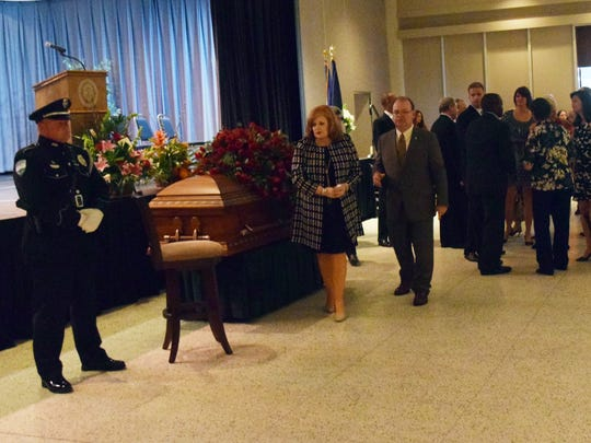 The public was invited to pay their respects Thursday as former Alexandria Mayor Ned Randolph was lying in repose in Convention Hall. In the  center is Deborah Randolph, the former mayor's widow.