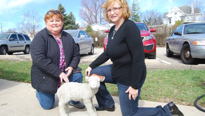 Cheviot Bicentennial Committee co-chairwomen Kathy Goedl, left, and Deb Laumann pose with a concrete sheep that was sold in conjunction with the city's bicentennial. Cheviot will celebrate its 200th anniversary in 2018.