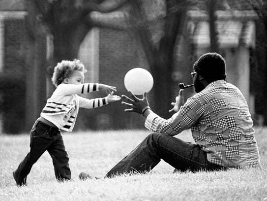 Eric Steward, 2, tosses a ball back and forth with