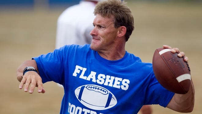 Burt Austin throws a ball to players at afternoon football practice at Franklin Central High School, Indianapolis, IN, Friday, August 5, 2011. Robert Scheer/The Star