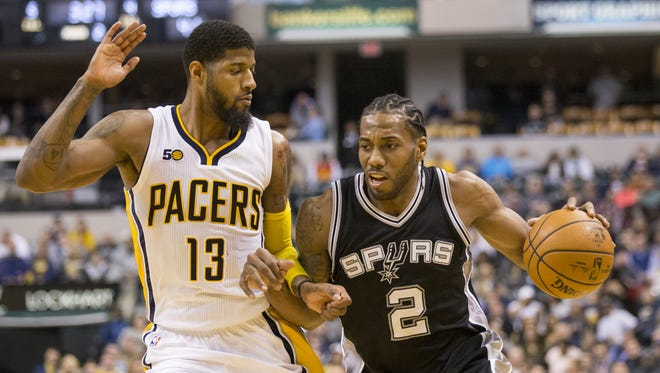 Paul George of Indiana, defends Kawhi Leonard of the San Antonio Spurs at Indiana Pacers, Bankers Life Fieldhouse, Indianapolis, Monday, February 13, 2017.