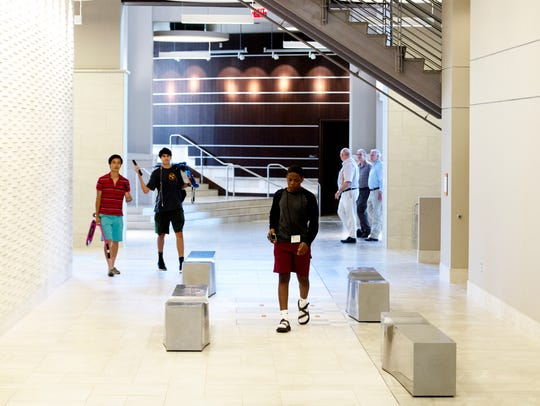 People walk through the lobby area at the newly revamped