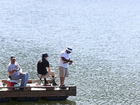 Ken Brock, left, and his grandson, Isaiah Ulloa, and son, Raul Ulloa, fish from the dock during free fishing day on Saturday, June 4, 2016, at the Silverton Reservoir.