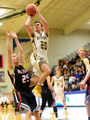 Old Fort's Jacob Webb floats past Arlington's Brock Oates in a Division IV district semifinal Wednesday. Webb scored 23 points.