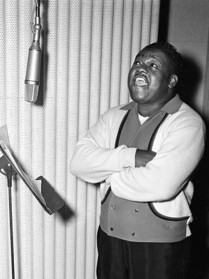 "Caption from a 1964 Tennessean story on Fats Domino: Antoine ""Fats"" Domino, once the undisputed king of rock and roll, is in Nashville Jan. 9, 1964, for a series of recording sessions. Under the direction of arranger-director Bill Justis, Domino is trying to get back in the hit column on ABC Paramount Records."