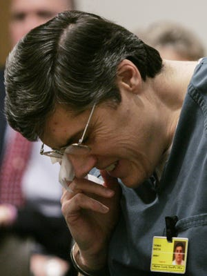 """In this March 18, 2005, file photo, former Springboro, Ohio, police Lt. Thomas """"Jim"""" Barton wipes away a tear during his sentencing hearing in Warren County Court in Lebanon, Ohio. The U.S. Supreme Court on Monday, March 21, 2016, declined to consider reinstating Barton's conviction linking him to a botched burglary that led to the April 1995 death of his 40-year-old wife, Vickie Barton, in the couple's farmhouse in rural Franklin Township, 30 miles north of Cincinnati. In 2015, the 6th U.S. Court of Appeals ordered a new trial, saying authorities withheld evidence that could have helped Barton discredit the charges."""