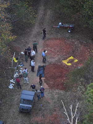 Law enforcement excavate the property at the Wofford Rd. crime scene on Friday, November 4, 2016