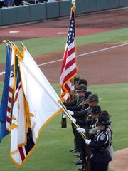 A color guard made up of customs and immigration agents took the field at the start of the game between the El Paso Chihuahuas and the Tacoma Rainiers Thursday night.