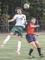 Delbarton's Mark Forbes (12) heads the ball away from