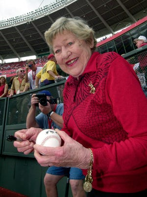 In this Sept. 22, 2002 file photo former Cincinnati Reds majority owner Marge Schott signs autographs prior to the final game at Cinergy Field in Cincinnati. Schott was a divisive figure when she owned the Cincinnati Reds, getting suspended and ultimately forced out for her racially offensive language. The community is debating what to do with facilities named in her memory.