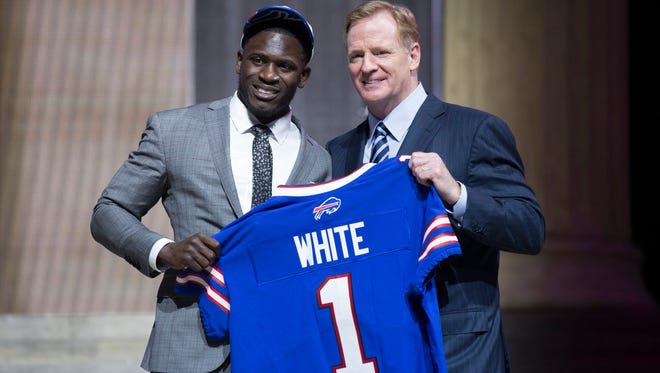 Tre'Davious White (LSU) poses with NFL commissioner Roger Goodell (right) as he  is selected as the number 27 overall pick to the Buffalo Bills in the first round the 2017 NFL Draft at the Philadelphia Museum of Art.