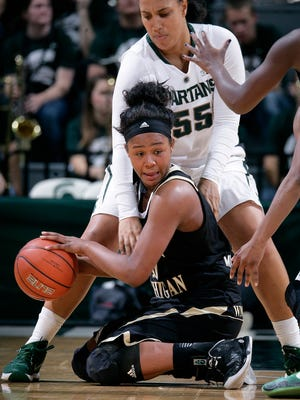 Western Michigan's Breanna Mobley, bottom, and Michigan State's Kennedy Johnson (55) fight for the ball Sunday, Nov. 15, 2015, in East Lansing, Mich. Michigan State won 78-40.