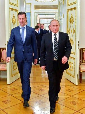 Russian President Vladimir Putin, right, and Syria President Bashar Assad