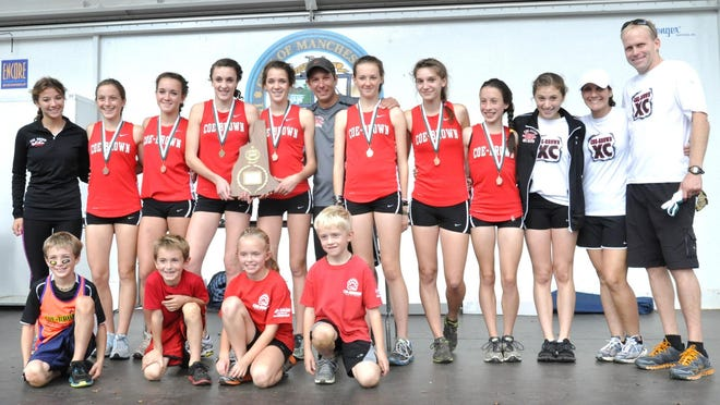 The Coe-Brown Northwood Academy girls cross country team is pictured in 2012 after winning the Division II championship at Derryfield Park in Manchester. The Bears won six straight D-II titles from 2010 to 2015.