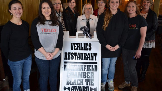 Verlies Restaurant received the Morganfield  Chamber of Commerce's Black Tie Award.. The sign was presented January 12.  From the left are Kristie Collins; owner Audrey Erickson; DMI Executive Director Carolyn Eiter; Chamber President Karen Shockley; Mary Wood; LaDonna Tapp; Danielle Duckworth; Dee Duckworth; and Chamber Vice President Tammy Blue.  Wood and Tapp chair the Black Tie award, which is  given monthly to the local  business that maintains an attractive storefront and landscaping.