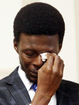 Former Kinnelon resident Francis Thomas wipes a tear from his eye while he testifies in his defense in Morris County Superior Court. Thomas is charged with attempting to murder his mother's ex-boyfriend at a home they shared in Smoke Rise development in Kinnelon. April 25, 2017, Morristown, NJ