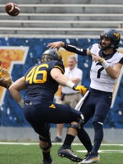 FILE - In this April 15, 2017, file photo, West Virginia quarterback Will Grier (7) throws a pass during the first half of an NCAA college football spring game, in Morgantown, W. Va. The NCAA has cleared transfer quarterback Will Grier to play at West Virginia at the start of the season. West Virginia coach Dana Holgorsen confirmed Grier's eligibility Tuesday, June 20, 2017. (AP Photo/Raymond Thompson, File)