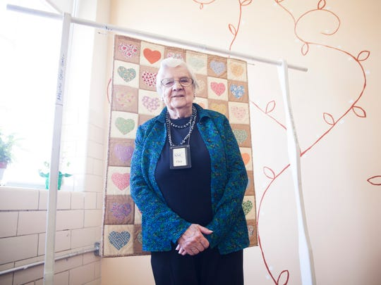 Dot Desper, 91, stands in front of a quilt on display at the Staunton Senior Center before their celebration of members over 90 years old on Wednesday, March 18, 2015.