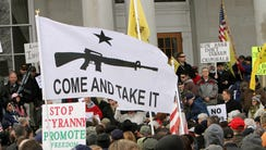 Hundreds of gun supporters rally at the New Hampshire