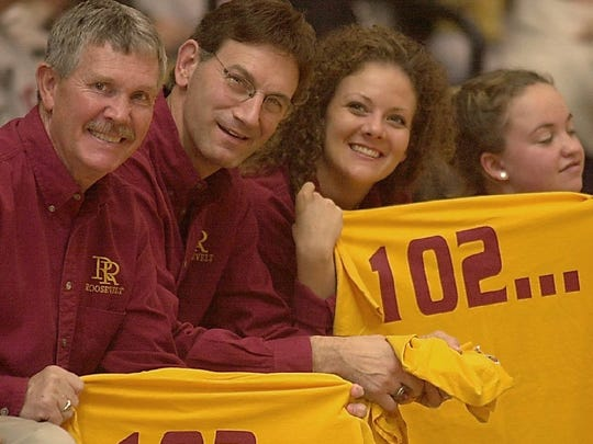Roosevelt coaches Larry Toft, Fred Tibbetts and Denise Klein hold up their 102 win shirts as the final seconds tick off the clock in Sturgis.