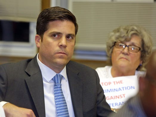 Greg Lobato listens as people speak on his behalf during a meeting of the Sleepy Hollow  board of trustees Aug. 12, 2014.  Labato is a Marine Corps captain who was denied a spot on the Sleepy Hollow police department by the village board of trustees..