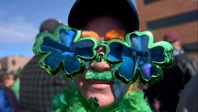 Julie Weisser dons a costume for the 38th annual St. Patrick's Day Parade on Saturday, March 18, 2017 in downtown Sioux Falls, S.D.
