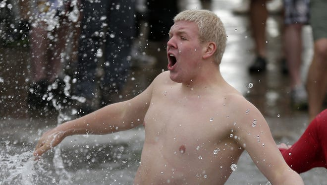 The 2015 Polar Bear Plunge at Becker Marine on January 1, 2015 in Waupaca, Wis. Money raised during this year's plunge will benefit the Waupaca Fire Department. Wm.Glasheen/Post-Crescent Media