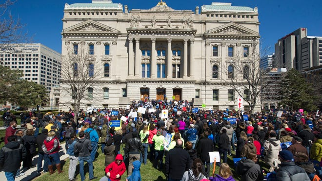 Thousands of opponents of the Religious Freedom Restoration Act gathered on the lawn of the Indiana State House to rally against it Saturday.