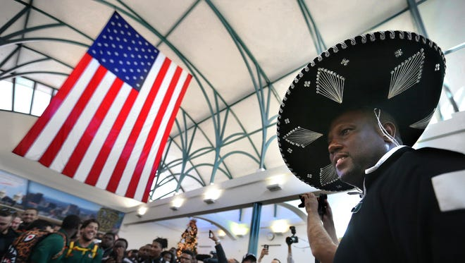 University of Miami interim head coach Larry Scott dons a sombrero as he as the Hurricanes are welcomed to El Paso Monday. Miami will face Washington State in the Sun Bowl on December 26.