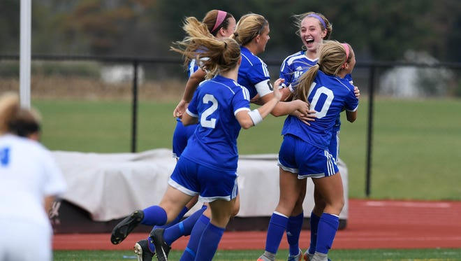 Memorial freshman Ryleigh Anslinger gets mobbed by her teammates after scoring one of her three goals Saturday against Bishop Chatard in the IHSAA Class 2A Evansville Semistate. The Tigers won 7-0 to advance to the state finals.