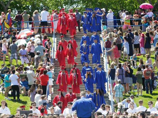 Graduates file down Vollrath Bowl at the start of The Sheboygan Area School District Commencement Sunday June 4, 2017 in Sheboygan, Wis.