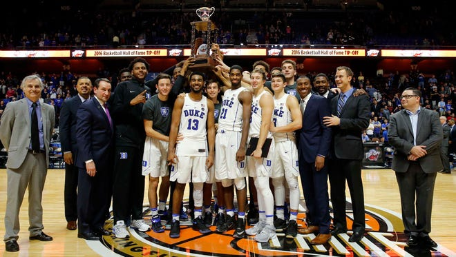 The Duke Blue Devils hold up the Hall of Fame Tip Off trophy after defeating the Rhode Island Rams.