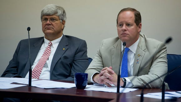 Sen. Trip Pittman, left, and Sen. Cam Ward, right, listen during committee discussion on the autism insurance bill at the Alabama Statehouse in Montgomery, Ala., on Thursday May 4, 2017.