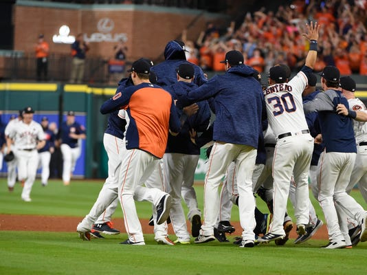 Houston Astros players celebrate after Game 7 of baseball's American League Championship Series against the New York Yankees Saturday, Oct. 21, 2017, in Houston. The Astros won 4-0 to win the series. (AP Photo/Eric Christian Smith)