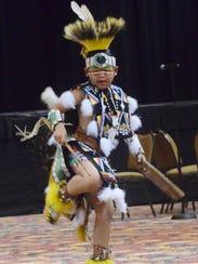 Sinte-Ska Roberts dances the chicken dance in a dance
