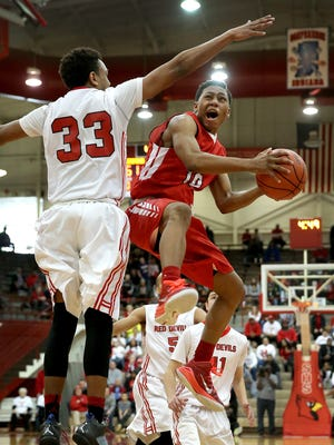 Pike's Justin Roberts,right, drives on Richmond's Auntonio Brown,left,  in the second half of their game. Richmond defeated Pike  78-66 Saturday, March 14, 2015, morning in the Regional at Southport.