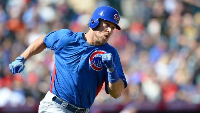 Feb 23, 2013: Chicago Cubs center fielder Brett Jackson (7) triples during the second inning against the Los Angeles Angels at Tempe Diablo Stadium.