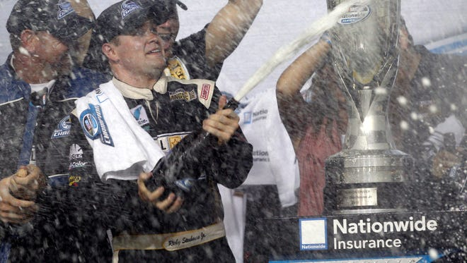 Ricky Stenhouse Jr celebrates after winning his first NASCAR Nationwide series championship. Nationwide announced Wednesday it won't sponsor the NASCAR circuit after the 2014 season.
