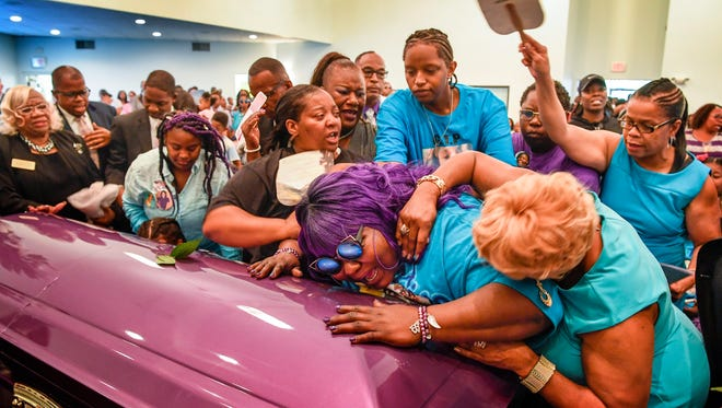 Friends and family try to comfort Tika Begley as they close her daughter Debrianah Begley's casket during the funeral at the Bethesda Original Church of God in Nashville, Tenn., Saturday, October 14, 2017.