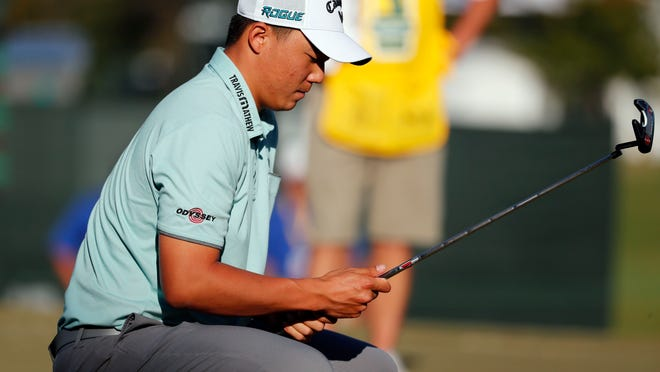 Norman Xiong looks at his putter before hitting on the 18th hole during the third day of the Sanderson Farms Championship at The Country Club of Jackson. Xiong, who shared the second-round lead, shot a 4-over 76 Saturday. (AP Photo/Rogelio V. Solis)