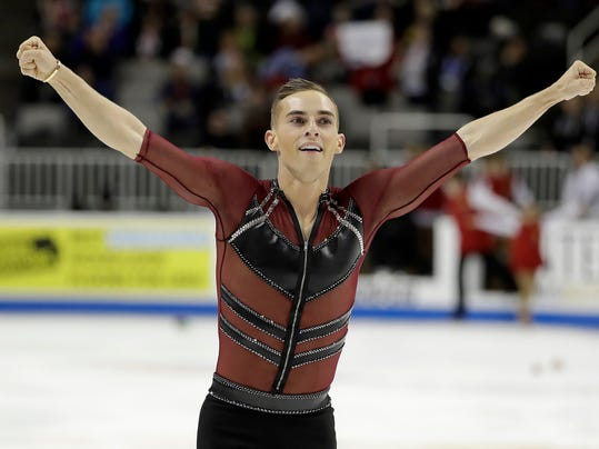 FILE - In this Jan. 4, 2018, file photo, Adam Rippon performs during the men's short program at the U.S. Figure Skating Championships in San Jose, Calif. Rippon remains open to speaking with Mike Pence over the vice president's conservative stance on gay rights after the Pyeongchang Olympics. The openly gay Rippon criticized the White House last month for choosing Pence to lead the official U.S. delegation for the Friday, Feb. 9, 2018, opening ceremony. (AP Photo/Marcio Jose Sanchez, File)