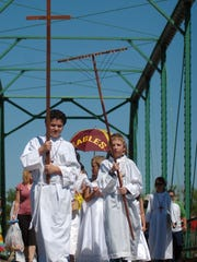 Tim Trujillo, left, and Nathan Smallidge, lead the procession during a recent Blessing of the Fields ceremony at the New Mexico Farm & Ranch Heritage Museum.