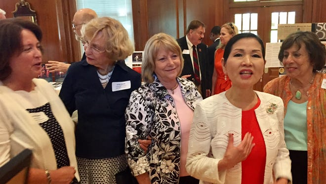 In this Tuesday, June 13, 2017 photo, artist and Maryland First Lady Yumi Hogan (front in red dress) gathers with local supporters of the arts at the annual luncheon meeting of the Salisbury Wicomico Arts Council that celebrates its 50th anniversary this year. With her are from left, Donna Brittingham, development officer at Salisbury University that hosted the luncheon, Salisbury businesswoman Jackie Cassidy, Susan Walsh, a SWAC supporter and Sue Hess, a retired Salisbury dancer and businesswoman credited for planting the seeds for what has grown into SWAC, the state's first incorporated arts council.