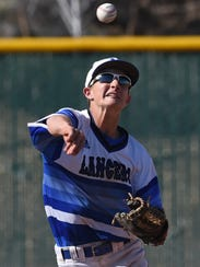 McQueen's Logan Anderson gets the ball in for the Lancers