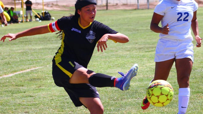 Alamogordo's Angel Flores takes a shot at the goal Saturday afternoon at the Riner Steinoff Soccerplex.