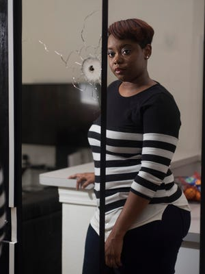 Escambia County resident, Sahara Fairley, is still looking for answers, on Tuesday, June 26, 2018, after a gunshot over the weekend blow out her glass patio door, and the slug lodged in the wall in her kitchen. Fairley is disappointed that her interaction with the sheriff's office and calls it less than helpful.